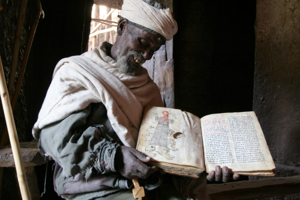Send picture of Priest in Lalibela with a book more than a thousand years old from Ethiopia as a free postcard