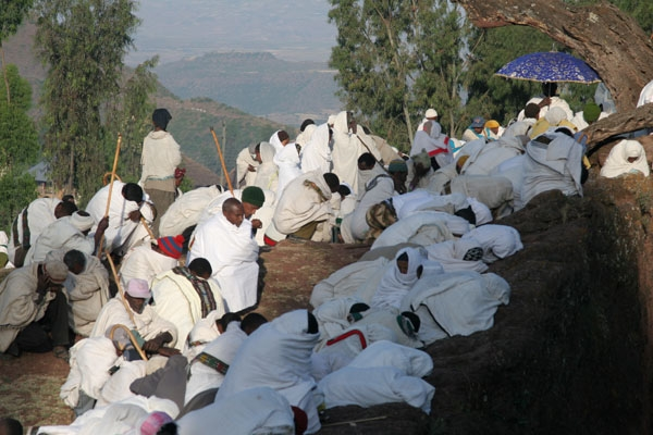 Send picture of People dressed in white for a religious ceremony in Lalibela from Ethiopia as a free postcard