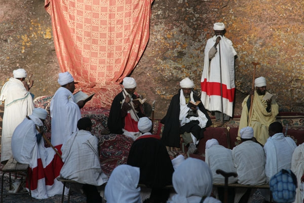 Priests performing Sunday mass in a Lalibela church