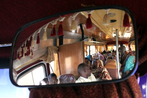 Send picture of Ethiopian bus passengers reflected from Ethiopia as a free postcard
