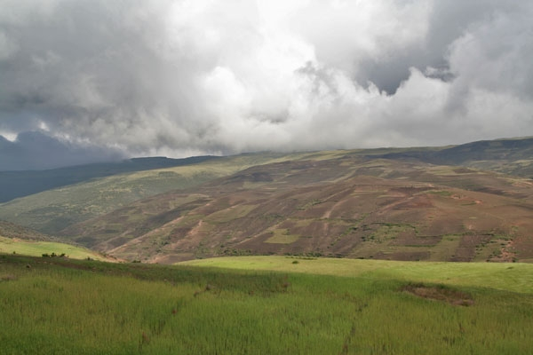 Green fields and clouds in the Simien mountains