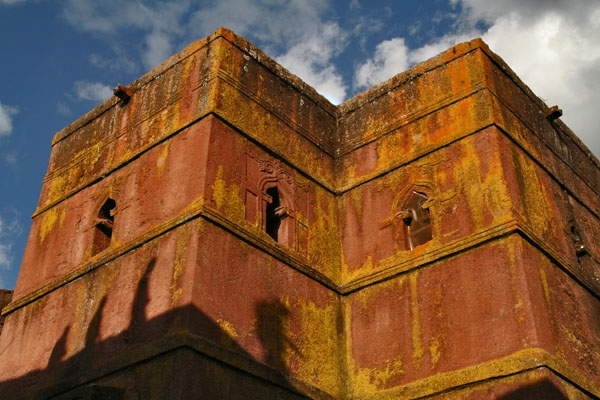 Send picture of Sun and shadows on a church in Lalibela from Ethiopia as a free postcard
