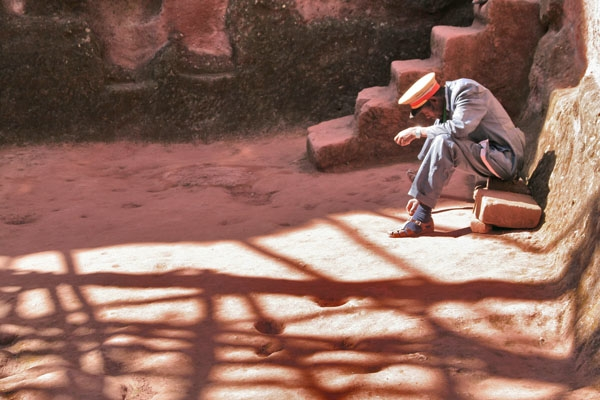 Man working as guard of one of the many churches in Lalibela