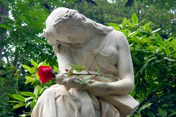Send picture of Statue at Chopin's grave at Pere Lachaise cemetery from France as a free postcard