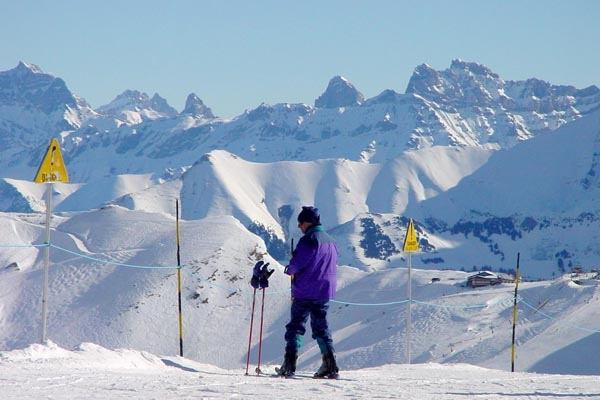 Send picture of Skiing at Morzine ski resort from France as a free postcard