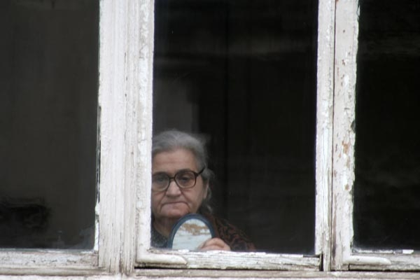 Send picture of Elderly woman in her Tblisi home from Georgia as a free postcard