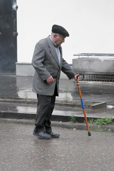 Send picture of Elderly man in the streets of Tblisi from Georgia as a free postcard