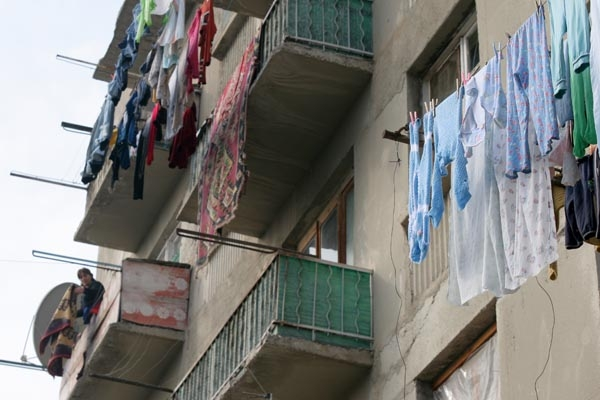 Send picture of Clothes hanging to dry on Tblisi balconies from Georgia as a free postcard