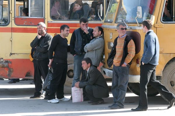 Send picture of Passengers at Gori bus station from Georgia as a free postcard