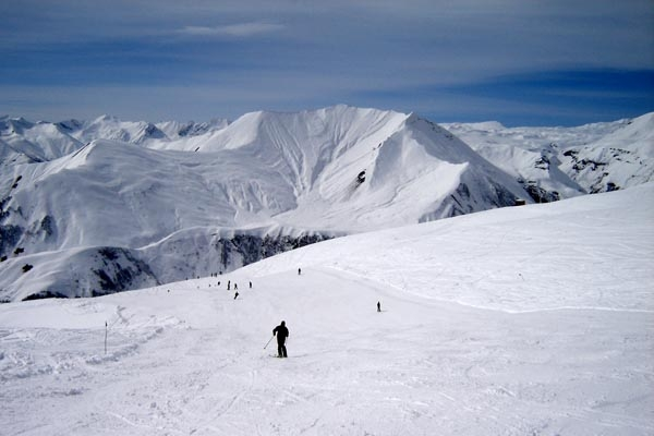 Send picture of Skiing at the Gudauri ski area from Georgia as a free postcard