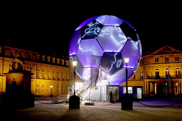 Send picture of The iluminated football globe in Stuttgart during the 2006 World Cup from Germany as a free postcard