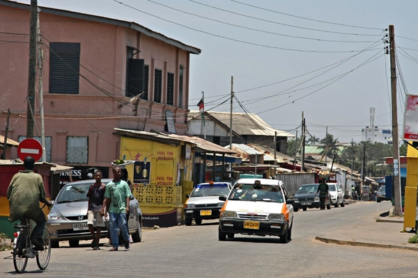 Send picture of Taxi, cyclist and pedestrians in Accra from Ghana as a free postcard