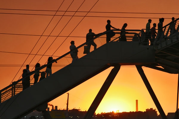Send picture of Pedestrian bridge in Piraeus at dusk from Greece as a free postcard