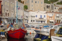 Foto van Houses on the harbor of Hydra - Greece