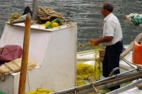 Foto van Fisherman on Hydra island - Greece