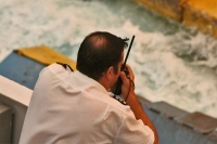 Foto van Man working on a ferry - Greece