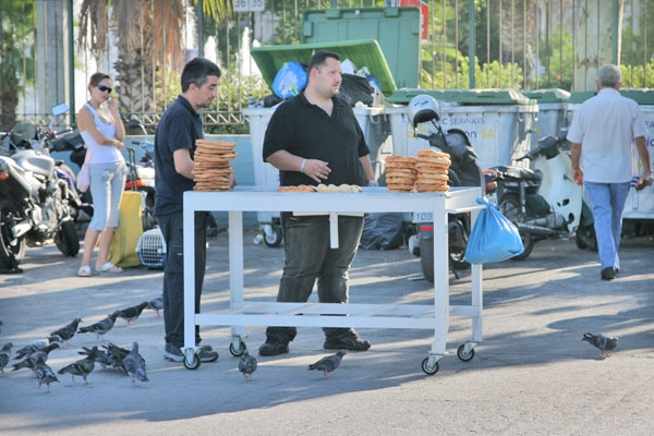 Send picture of Bread vendor in Piraeus harbor from Greece as a free postcard