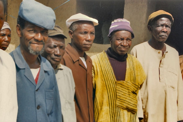 Send picture of Men in a Guinean village from Guinea as a free postcard