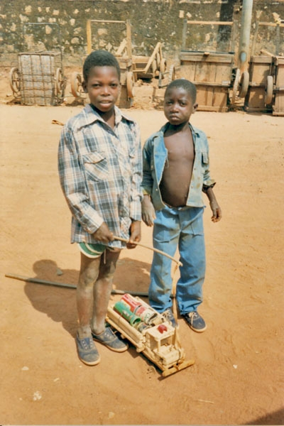 Send picture of Guinean boys with home made toy from Guinea as a free postcard