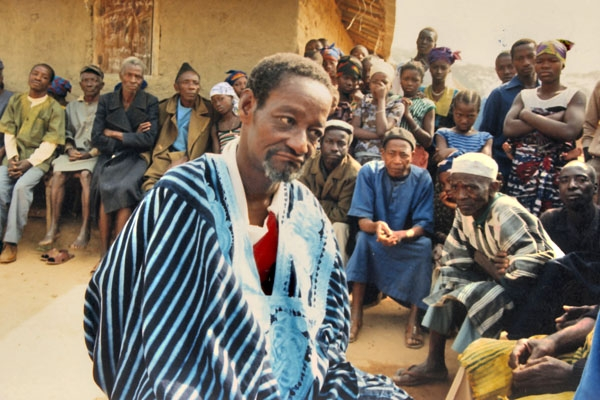Send picture of People in a Guinean village: meeting of the elderly from Guinea as a free postcard