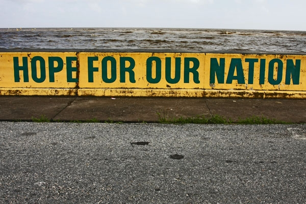 Send picture of Advertisement on the sea wall in Georgetown from Guyana as a free postcard