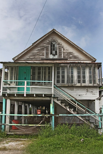 Send picture of Wooden house on stilts in Georgetown from Guyana as a free postcard