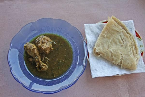 Send picture of Curry and chicken  served with roti from Guyana as a free postcard