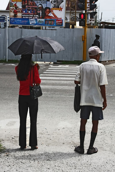 Send picture of Woman with parasol in Georgetown from Guyana as a free postcard