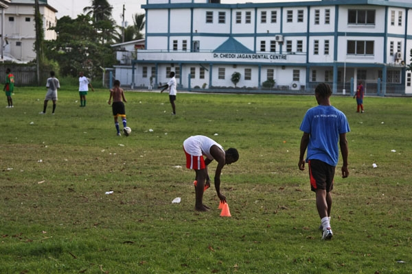 Send picture of Young men playing football in Georgetown from Guyana as a free postcard