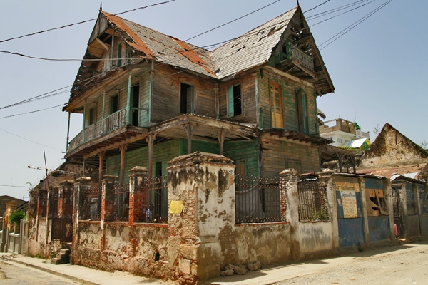 Send picture of Decaying gingerbread house in Cap Haitien from Haiti as a free postcard