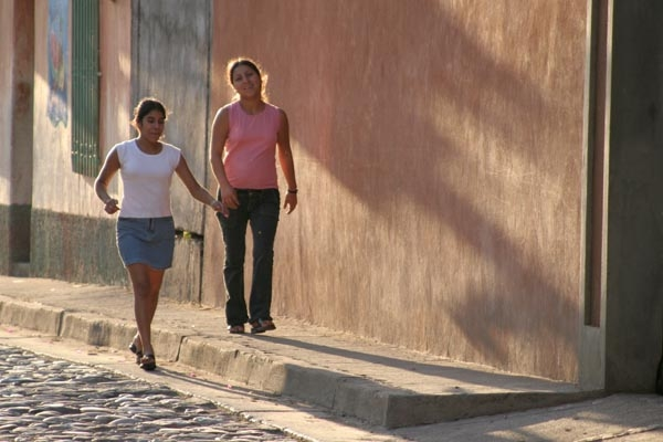 Girls and shadows in a Copán street