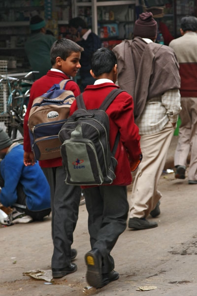 Send picture of Boys walking to school in Delhi from India as a free postcard