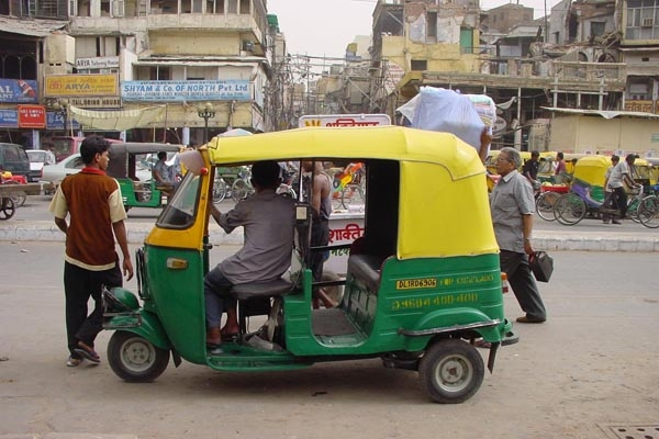 Send picture of A waiting rickshaw in Delhi from India as a free postcard
