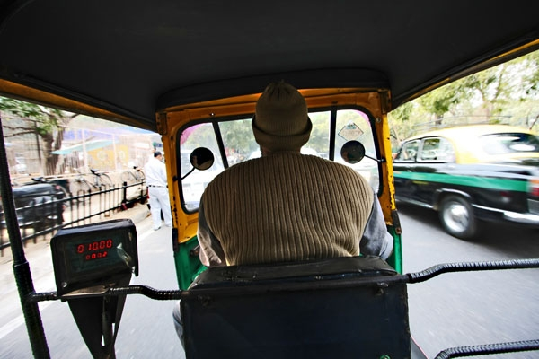 Send picture of Inside a rickshaw in Delhi from India as a free postcard