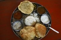 Picture of Traditional Indian food with Poppadom, rice, sauces and yoghurt dips - India