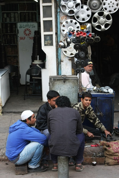 Send picture of Young men working in a car shop in Delhi from India as a free postcard