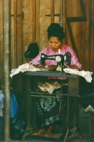 Foto di Woman sewing clothes on Bali island - Indonesia
