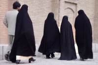 Picture of Iranian women dressed in a chador and man - Iran