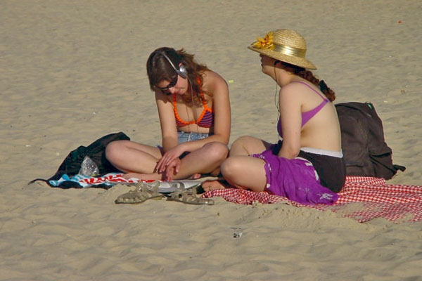 Send picture of Young women enjoying the sun on the beach in Tel Aviv from Israel as a free postcard