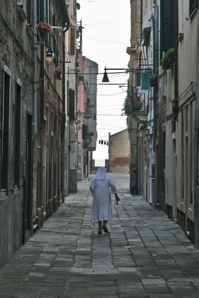 Nun walking the streets of Venice