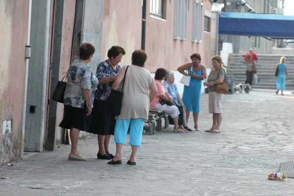  Women chatting in the street in Venice