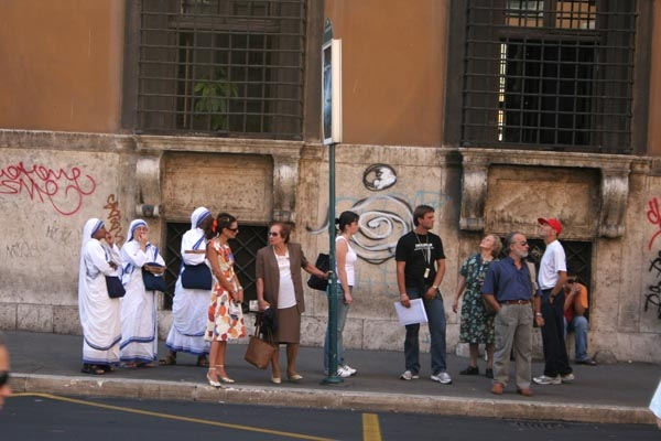 Send picture of Waiting for the bus in Rome from Italy as a free postcard