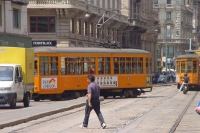 Picture of Trams, cars, pedestrians and scooters in Milan - Italy