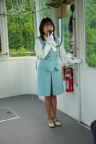 Send picture of Japanese woman working in a gondola lift from Japan as a free postcard