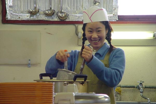 Send picture of Woman working as a cook from Japan as a free postcard