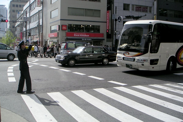 Send picture of Traffic cop in Osaka from Japan as a free postcard