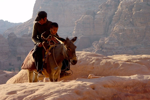 Young man and boy on a mule