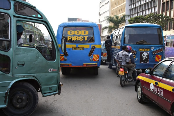 Send picture of Buses, taxis and mopeds in Nairobi from Kenya as a free postcard