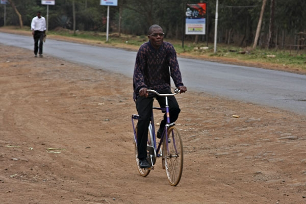 Send picture of Man cycling in Karen from Kenya as a free postcard