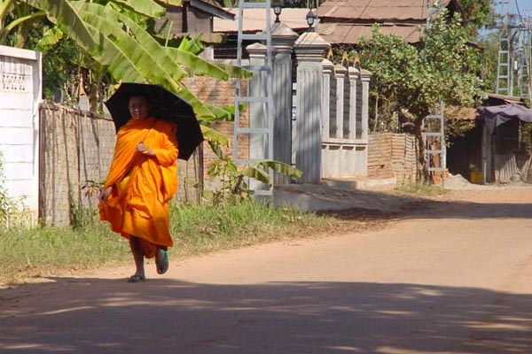 Send picture of Monk walking a street in Vientiane from Laos as a free postcard